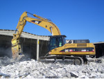 demolizione ruspa escavatore